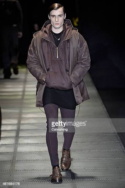 Model walks the runway at the Versace Autumn Winter 2015 fashion show during Milan Menswear Fashion Week on January 17, 2015 in Milan, Italy.