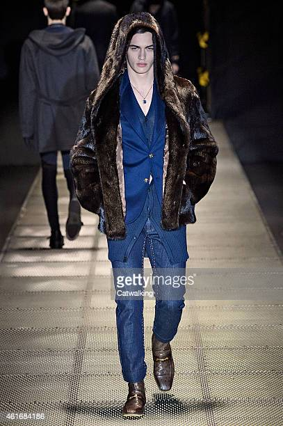 A model walks the runway at the Versace Autumn Winter 2015 fashion show during Milan Menswear Fashion Week on January 17 2015 in Milan Italy