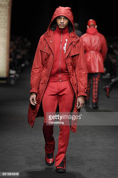 A model walks the runway at the Versace Autumn Winter 2017 fashion show during Milan Menswear Fashion Week on January 14 2017 in Milan Italy