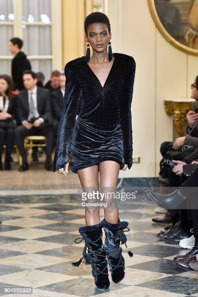 A model walks the runway at the Versace Autumn Winter 2018 fashion show during Milan Menswear Fashion Week on January 13 2018 in Milan Italy