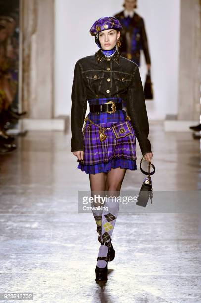 A model walks the runway at the Versace Autumn Winter 2018 fashion show during Milan Fashion Week on February 23 2018 in Milan Italy