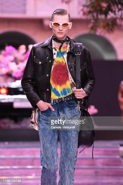 A model walks the runway at the Versace fashion show during the Milan Men's Fashion Week Spring/Summer 2020 on June 15 2019 in Milan Italy