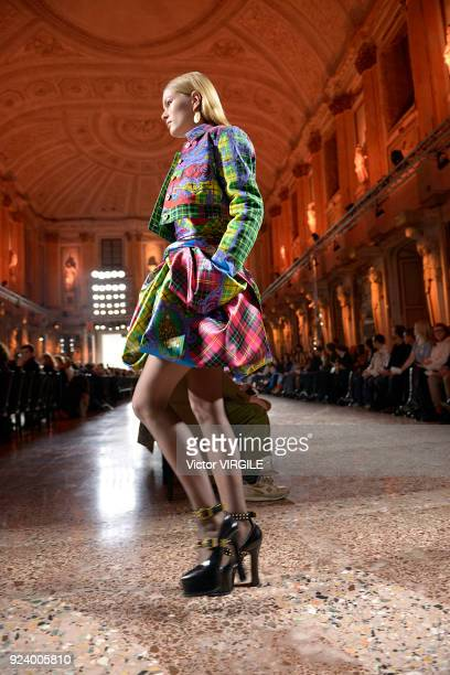 A model walks the runway at the Versace Ready to Wear Fall/Winter 20182019 fashion show during Milan Fashion Week Fall/Winter 2018/19 on February 23...