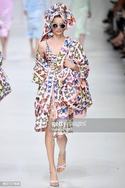 A model walks the runway at the Versace Ready to Wear Spring/Summer 2018 fashion show during Milan Fashion Week Spring/Summer 2018 on September 22...