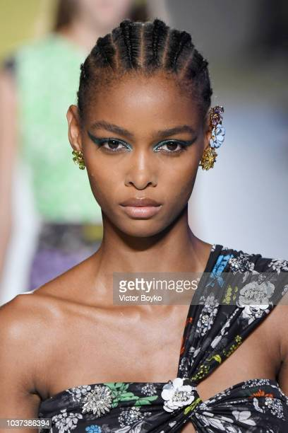 A model walks the runway at the Versace show during Milan Fashion Week Spring/Summer 2019 on September 21 2018 in Milan Italy
