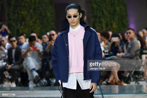A model walks the runway at the Versace show during Milan Men's Fashion Week Spring/Summer 2018 on June 17 2017 in Milan Italy