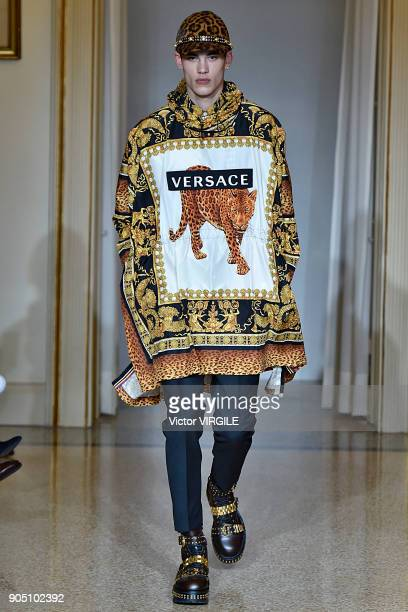A model walks the runway at the Versace show during Milan Men's Fashion Week Fall/Winter 2018/19 on January 13 2018 in Milan Italy