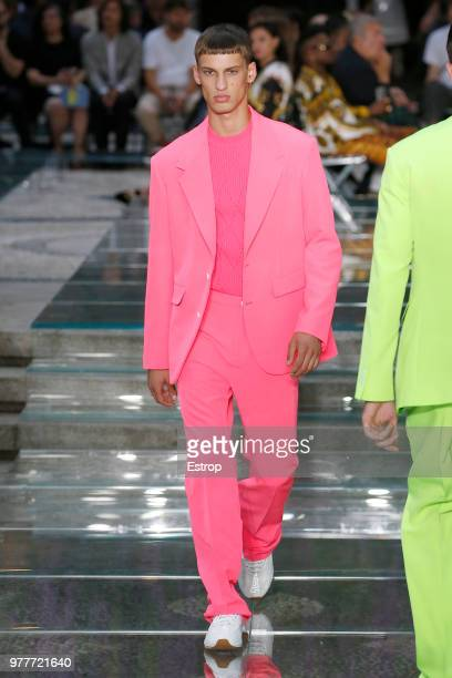 A model walks the runway at the Versace show during Milan Men's Fashion Week Spring/Summer 2019 on June 16 2018 in Milan Italy