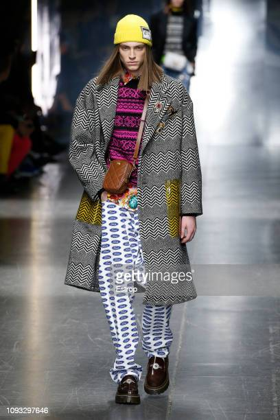 A model walks the runway at the Versace show during Milan Menswear Fashion Week Autumn/Winter 2019/20 on January 12 2019 in Milan Italy