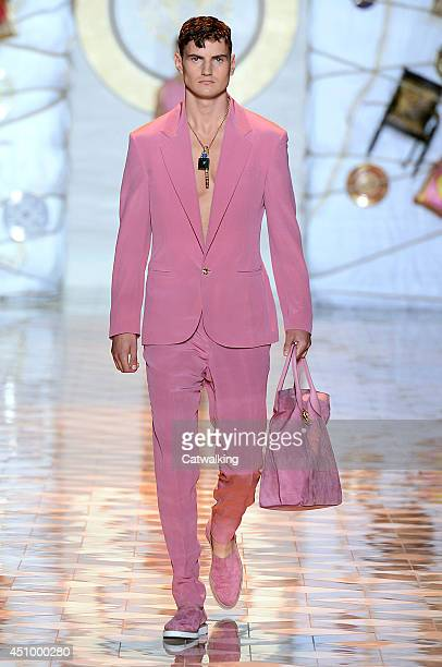 A model walks the runway at the Versace Spring Summer 2015 fashion show during Milan Menswear Fashion Week on June 21 2014 in Milan Italy