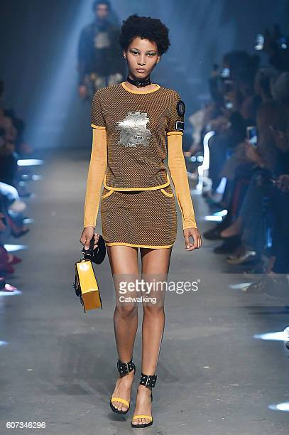 Model walks the runway at the Versus Versace Spring Summer 2017 fashion show during London Fashion Week on September 17, 2016 in London, United...