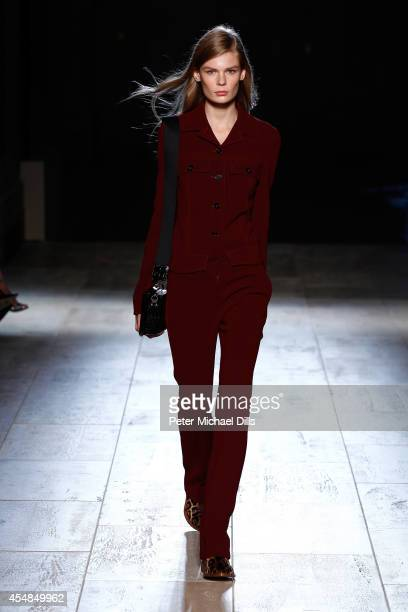 A model walks the runway at the Victoria Beckham fashion show during MercedesBenz Fashion Week Spring 2015 at The Cunard Building on September 7 2014...