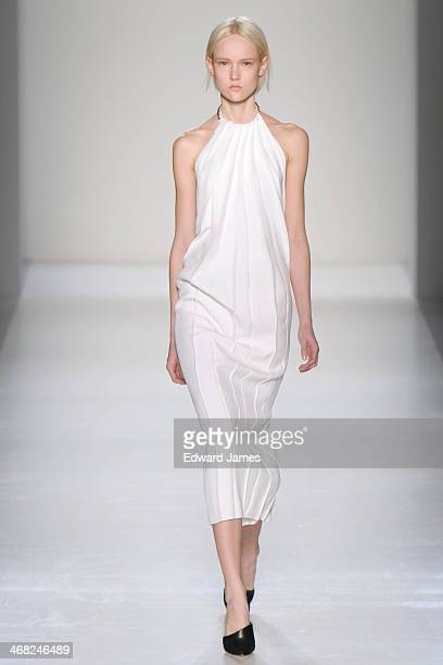 Model walks the runway at the Victoria Beckham show during Mercedes-Benz Fashion Week Fall 2014 at Cafe Rouge on February 9, 2014 in New York City.
