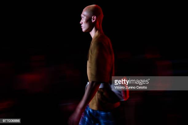 A model walks the runway at the Vien show during Milan Men's Fashion Week Spring/Summer 2019 on June 17 2018 in Milan Italy