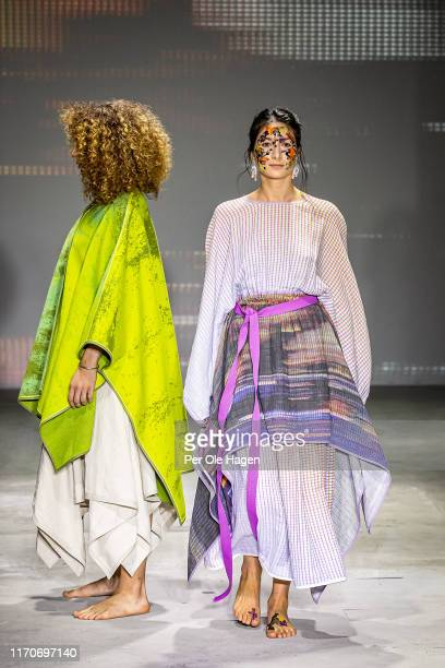 A model walks the runway at the viewing of Norwegian designer Tonje Plur's designs at the Fushion Fashion Art Festival on August 28 2019 in Oslo...