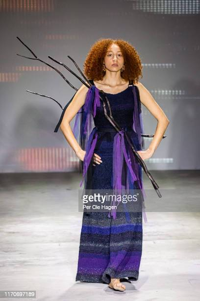 A model walks the runway at the viewing of Norwegian designer Tonje Plur's designs during the Fushion Fashion Art Festival on August 28 2019 in Oslo...