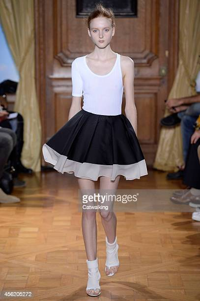A model walks the runway at the Viktor Rolf Spring Summer 2015 fashion show during Paris Fashion Week on September 27 2014 in Paris France