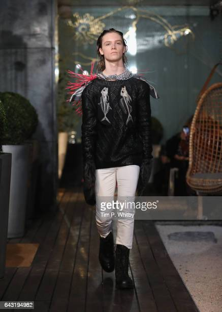 A model walks the runway at the Vin Omi show during the London Fashion Week February 2017 collections on February 20 2017 in London England