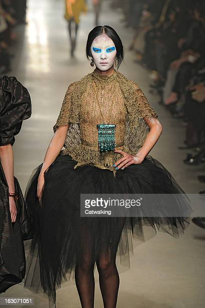 A model walks the runway at the Vivienne Westwood Autumn Winter 2013 fashion show during Paris Fashion Week on March 2 2013 in Paris France