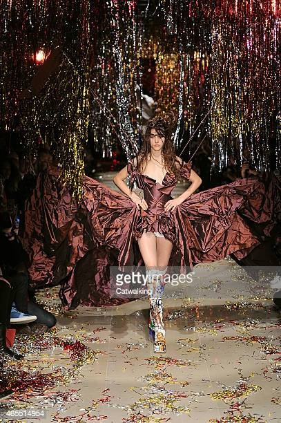 A model walks the runway at the Vivienne Westwood Autumn Winter 2015 fashion show during Paris Fashion Week on March 7 2015 in Paris France