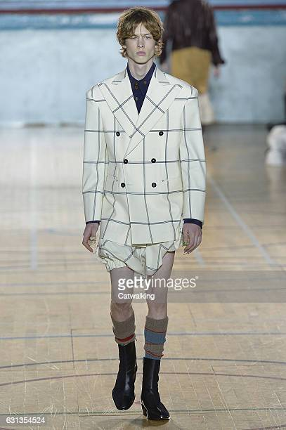 A model walks the runway at the Vivienne Westwood Autumn Winter 2017 fashion show during London Menswear Fashion Week on January 9 2017 in London...