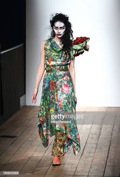Model walks the runway at the Vivienne Westwood Red Label show during London Fashion Week SS14 at on September 15, 2013 in London, England.