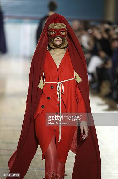 Model walks the runway at the Vivienne Westwood show during London Fashion Week Men's January 2017 collections at Seymour Leisure Centre on January...