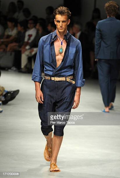 A model walks the runway at the Vivienne Westwood show during Milan Menswear Fashion Week Spring Summer 2014 on June 23 2013 in Milan Italy