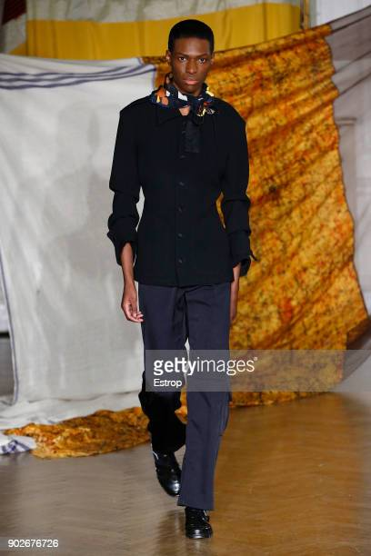 A model walks the runway at the WALES BONNER show during London Fashion Week Men's January 2018 at One Belgravia on January 7 2018 in London England