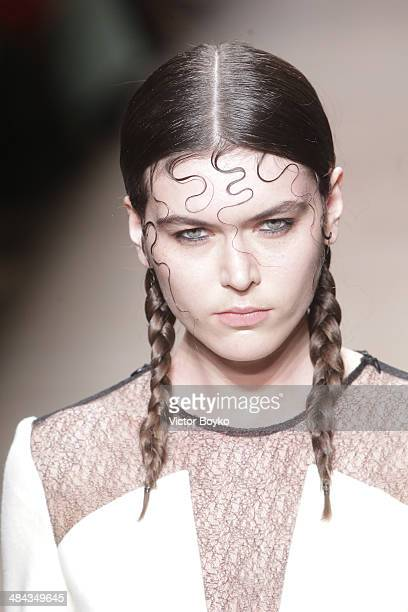 A model walks the runway at the Walk of Shame show during day 3 of Aurora Fashion Week Russia AW14 on April 11 2014 in Saint Petersburg Russia