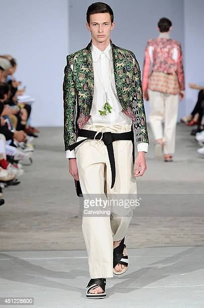 Model walks the runway at the Walter Van Beirendonck Spring Summer 2015 fashion show during Paris Menswear Fashion Week on June 25, 2014 in Paris,...