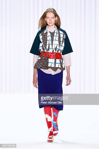 A model walks the runway at the Wataru Tominaga presented by MercedesBenz Elle show during the MercedesBenz Fashion Week Berlin Spring/Summer 2017 at...