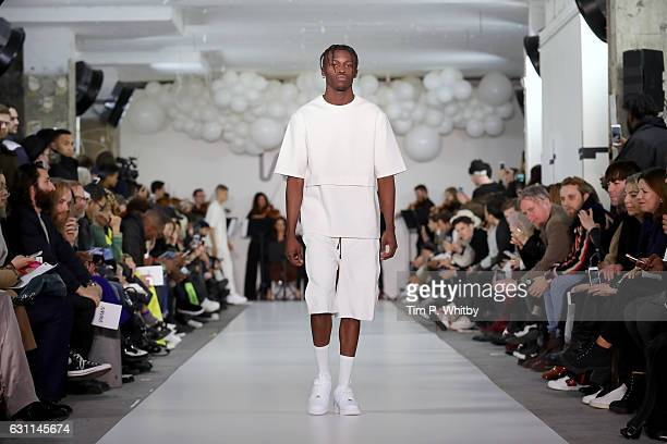 A model walks the runway at the What We Wear show during London Fashion Week Men's January 2017 collections at BFC Show Space on January 7 2017 in...