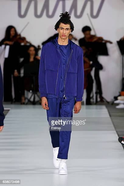 Model walks the runway at the What We Wear show during London Fashion Week Men's January 2017 collections at BFC Show Space on January 7, 2017 in...