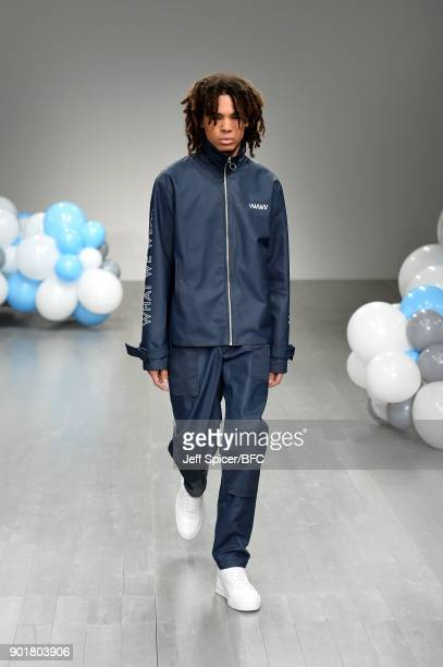 Model walks the runway at the What We Wear show during London Fashion Week Men's January 2018 at BFC Show Space on January 6, 2018 in London, England.