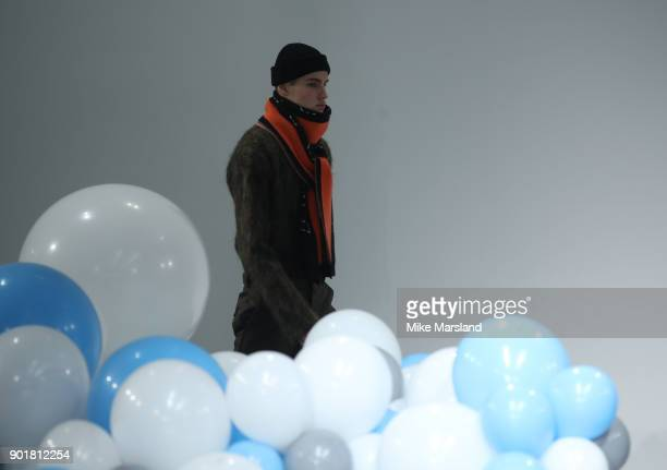 A model walks the runway at the What We Wear show during London Fashion Week Men's January 2018 at BFC Show Space on January 6 2018 in London England