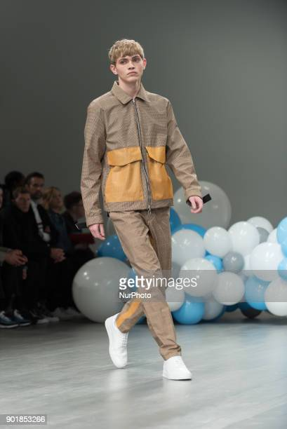 A model walks the runway at the What We Wear show during London Fashion Week Men's January 2018 London on January 6 2018 What We Wear is a London...