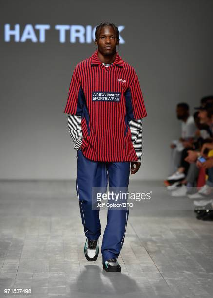 A model walks the runway at the What We Wear show during London Fashion Week Men's June 2018 at the BFC Show Space on June 11 2018 in London England
