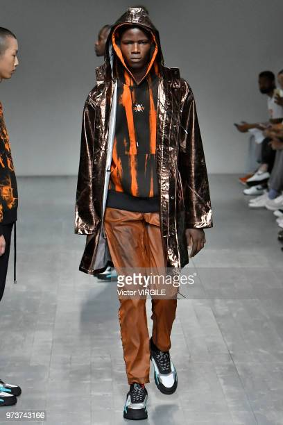 A model walks the runway at the What We Wear Spring/Summer 2019 fashionshow during London Fashion Week Men's June 2018 at the BFC Show Space on June...