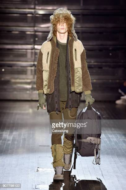 A model walks the runway at the White Mountaineering Autumn Winter 2018 fashion show during Paris Menswear Fashion Week on January 20 2018 in Paris...