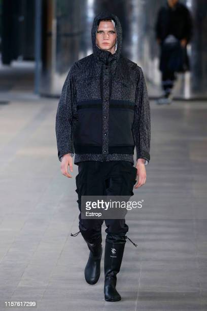A model walks the runway at the White Mountaineering show during Paris Men's Fashion Week Spring/Summer 2020 on June 22 2019 in Paris France