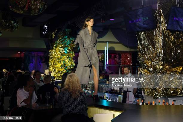 A model walks the runway at the William Fan Defile during 'Der Berliner Salon' Autumn/Winter 2019 at Knutschfleck on January 15 2019 in Berlin Germany