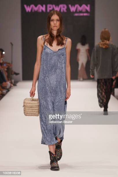A model walks the runway at the WMN PWR WMN show during Platform Fashion July 2018 at Areal Boehler on July 22 2018 in Duesseldorf Germany