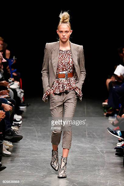 A model walks the runway at the Wunderkind designed by Wolfgang Joop show Milan Fashion Week Spring/Summer 2017 on September 21 2016 in Milan Italy