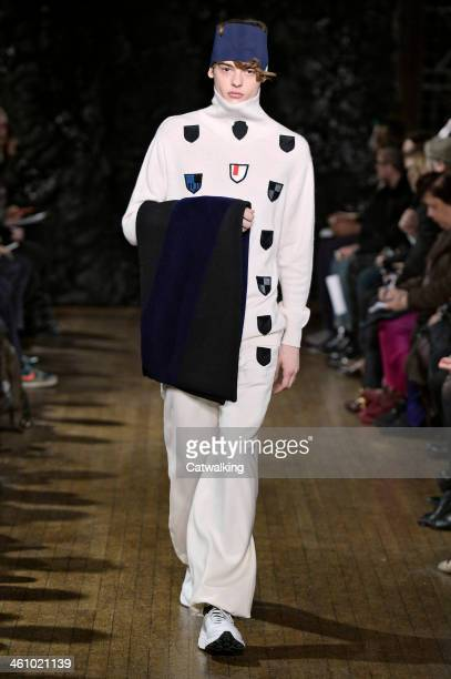 A model walks the runway at the Xander Zhou Autumn Winter 2014 fashion show during London Menswear Fashion Week on January 6 2014 in London United...
