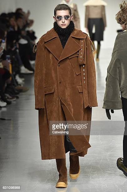 A model walks the runway at the Xander Zhou Autumn Winter 2017 fashion show during London Menswear Fashion Week on January 6 2017 in London United...
