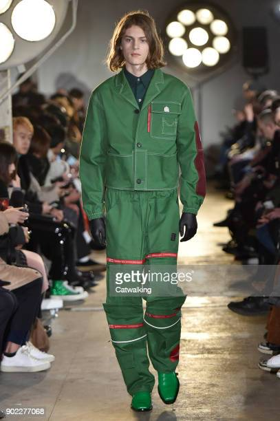A model walks the runway at the Xander Zhou Autumn Winter 2018 fashion show during London Menswear Fashion Week on January 6 2018 in London United...