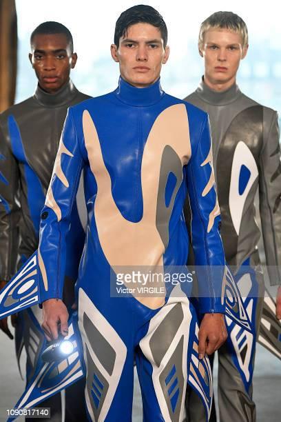 A model walks the runway at the Xander Zhou Fall/Winter 20192020 fashion show during London Fashion Week Men's January 2019 January 06 2019 in London...