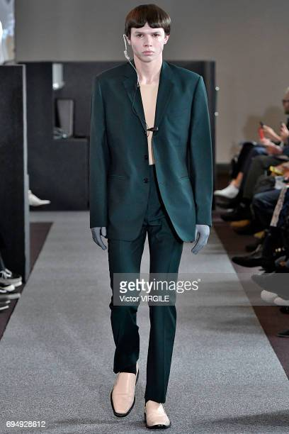 A model walks the runway at the Xander Zhou fashion show during the London Fashion Week Men's June 2017 Spring Summer 2018 collections on June 9 2017...