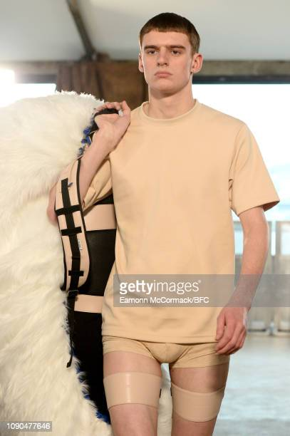 A model walks the runway at the Xander Zhou show during London Fashion Week Men's January 2019 January 06 2019 in London England